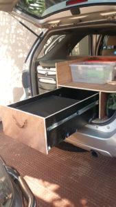Préparation pour votre road trip : les rangements dans le coffre